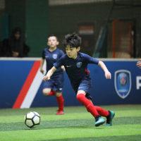 joueur en action enfant foot